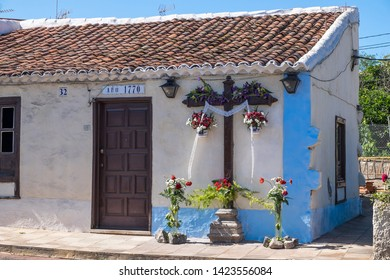 Tenerife, Canary islands - april 22, 2019: An old rural house with a cross decorated on its outer wall, on the outskirts of the city of La Laguna