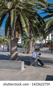 Tenerife, Canary islands - april 22, 2019: Street musician playing saxophone in a viewpoint of La Paz, in the tourist city of Puerto de la Cruz, north of the island