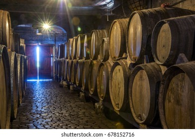 TENERIFE, CANARY ISLANDS - AUGUST 13, 2010: Light diffracted inside an old cellar with wooden barrels, in the north of the island