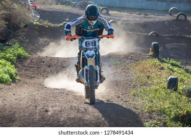Tenerife, Canary islands - December 29, 2018: Backlit image of two motocross riders running in a circuit on the coast of Bajamar, in the north of the island