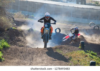 Tenerife, Canary islands - December 29, 2018: Backlit image of a motocross rider in a circuit on the coast of Bajamar, in the north of the island