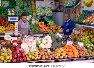 Tenerife, Canary islands - February 08, 2019: Shopkeepers inside a fruit and vegetable stand in the market of Our Lady of Africa, in the city of Santa Cruz