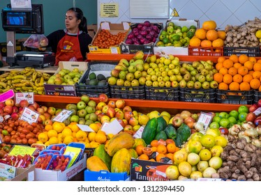 Tenerife, Canary islands - February 08, 2019: Exhibitors with fruits and vegetables in a market store of Our Lady of Africa, in the city of Santa Cruz