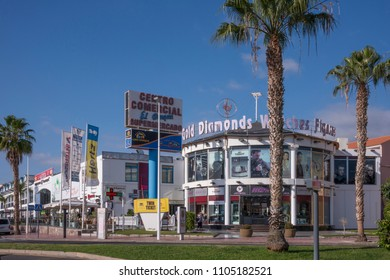 Tenerife, Canary islands - February 12, 2016: Exterior of the modern facade of a shopping center in the tourist city of Playa de las Americas, in the municipality of Adeje, south of the island