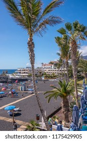 Tenerife, Canary islands - february 23, 2016: Slender palm trees and view of the Playa de la Arena on the west coast of the island