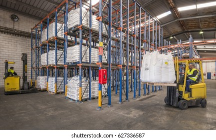 TENERIFE, CANARY ISLANDS - FEBRUARY 24, 2016: Forklifts, working in a warehouse of the industrial district in South Coast