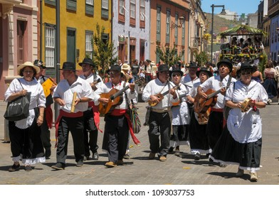 Tenerife, Canary islands - july 12, 2009: Group of men and women in traditional costumes singing through the streets of the historic city of La Laguna during the pilgrimage of San Benito Abad