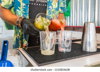 Tenerife, Canary islands - july 25, 2018: Serving cocktails at a beach bar on the seafront of Playa de las Americas, on the coast of Adeje in the south of the island