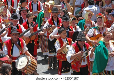TENERIFE, CANARY ISLANDS - JUNE 21, 2009: Musical group through the streets of the town of La Orotava Pilgrimage