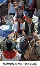 TENERIFE, CANARY ISLANDS - JUNE 21, 2009: Children dressed in traditional costumes of the area , on donkeys, in the Pilgrimage of Orotava