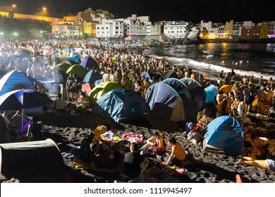 Tenerife, Canary islands - june 23, 2018: View of a crowd of people camped on the Playa Jardin of Puerto de la Cruz, in the celebration of the night of San Juan