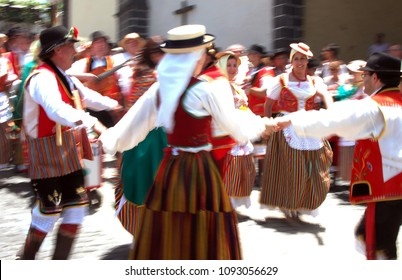 Tenerife, Canary islands - march 08, 2016: Blurred people dancing with motion blur in traditional pilgrimage in the streets of the village of La Orotava