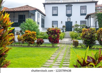 Tenerife, Canary islands - November 01, 2018: View of the entrance and gardens of an old mansion in the residential area of La Paz, in the tourist city of Puerto de la Cruz, on a cloudy day