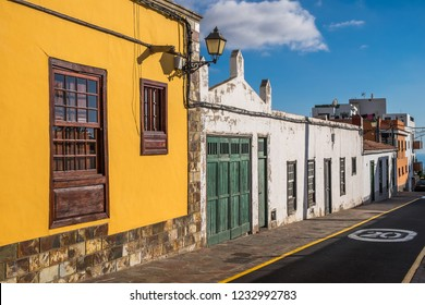 Tenerife, Canary islands - november 10, 2018: View of a street with traditional buildings in the urban center of the town of Arona, at sunset