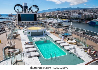 Tenerife, Canary islands - November 18, 2018: View of the pool deck of the Seaview cruise ship of the MSC company with the port and city of Santa Cruz in the background