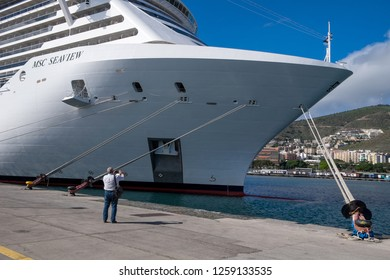Tenerife, Canary islands - November 18, 2018: Man photographing the prow of the cruise ship Seaview of the company MSC moored in one of the docks of the port of the city of Santa Cruz