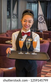 Tenerife, Canary islands - November 18, 2018: Waitress with tray of cocktails inside one of the dining rooms of the Seaview cruise of the MSC company moored in the port of the city of Santa Cruz