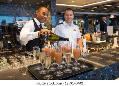 Tenerife, Canary islands - November 18, 2018: Waiter serving cocktails next to a department head in one of the bars of the Seaview cruise moored in the port of the city of Santa Cruz