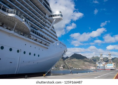 Tenerife, Canary islands - November 18, 2018: Perspective view of the MSC Seaview cruise ship in the port of Santa Cruz with two oil rigs in the background