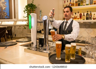 Tenerife, Canary islands - November 27, 2018: Waiter serving beers at the bar of a luxury restaurant in downtown Santa Cruz