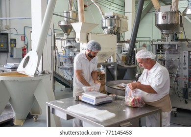 Tenerife, Canary islands - november 28, 2017: Two workers packing products in a flour factory