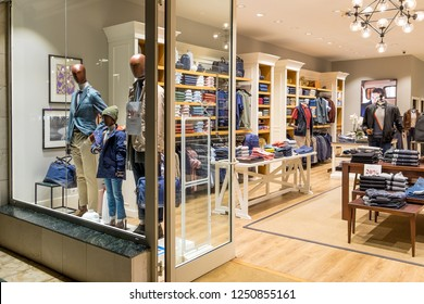 Tenerife, Canary islands - November 30, 2018: Shop windows and interior of a fashion store outside a modern shopping center in the tourist city of Playa de las Americas