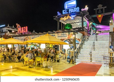 Tenerife, Canary islands - November 30, 2018: Nightlife in the bars and terraces of a modern shopping center in the tourist city of Playa de las Americas