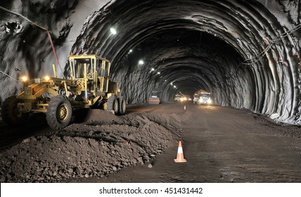 TENERIFE, CANARY ISLANDS - OCTOBER 19, 2010: Excavator working inside a tunnel under construction in the north of Tenerife