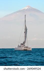TENERIFE, CANARY ISLANDS, SPAIN - 26 JANUARY 2014.  Catamaran in the ocean on a background of the volcano El Teide on Tenerife.