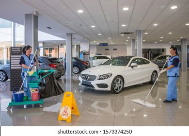 Tenerife, Canary islands, Spain - december 17, 2015: Women doing cleaning work inside an agency selling and distributing cars on the island