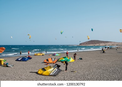 Tenerife, Canary Islands, Spain - september 2018: Many kitesurfer and windsurfer on ocean at surfer beach El Medano, Tenerife
