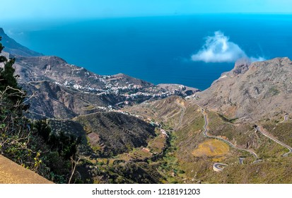 Tenerife, Canary Islands, Spain - The steep, rocky mountain landscape in the north of the island of Tenerife, overlooking Taganana Santa Cruz and the narrow road with tight hairpin bends.