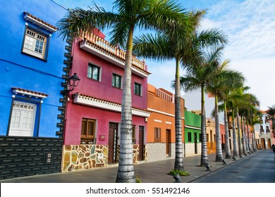 Tenerife. Colourful houses and palm trees on street in Puerto de la Cruz town, Tenerife, Canary Islands, Spain.