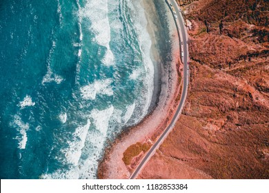 Tenerife Dramatic Sunset in Mountains. Landscape & Teal Light Shining Through Orange Clouds. Aerial Photography. Top View of Forest Road at Dusk Time. Teal Ocean Beach Mountains. Mountains Background