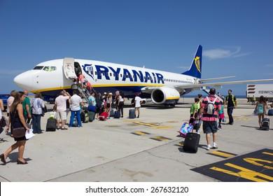 TENERIFE - JULY 16, 2014: Passengers boarding Ryanair flight, on July 16, 2014 in Tenerife. Ryanair is biggest budget low-cost airline in the world.