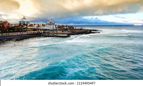 tenerife las americas vacation beautiful place. tropical iscland aerial view of ocean and waves and beach. nice colours and background. horizon and clouds in the morning