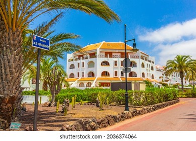 Tenerife Spain 12. July 2014 Palms coconut trees resorts and landscape panorama in Playa de las Americas of Canary Spanish island Tenerife in Africa.