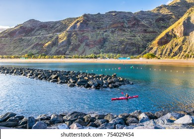 TENERIFE, SPAIN - APRIL 04, 2016: view of beach las Teresitas with yellow sand and with a kayak in the foreground on April 04, 2016 in Santa Cruz de Tenerife, Tenerife, Canary Islands.