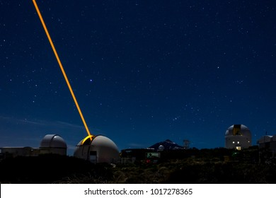 TENERIFE, SPAIN - APRIL 15, 2016: Laser beacon tests at the Teide Astronomical Observatory in a starry night