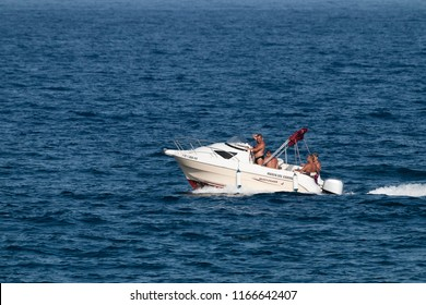 Tenerife, Spain, August 2018: Motor boat with men in bay of Candelaria.