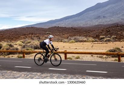 Tenerife, Spain December 24. 2018: Men cycling road bike in the Teide national Park. Spain