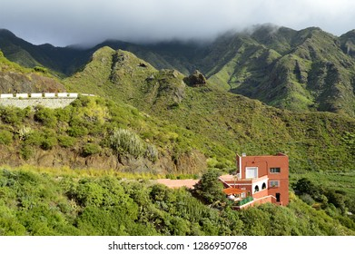 Tenerife, Spain - December 28, 2015: Rural house in the foothills of Anaga mountains, northeast of Tenerife Canary Islands. Trade winds from Atlantic ocean make this area wet and green.