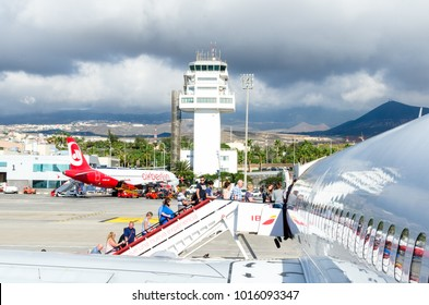 Tenerife, Spain - December 3, 2017: Storm clouds gather over Tenerife -South Airport (Aeropuerto de Tenerife Sur) as passengers, mainly holiday makes, begin to board a flight