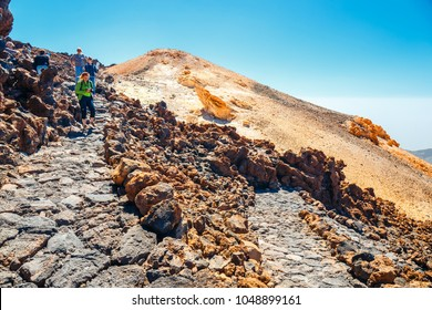Tenerife, Spain, June 07, 2015: unknown people are walking along the mountain path at the top of the el teide volcano, Spain