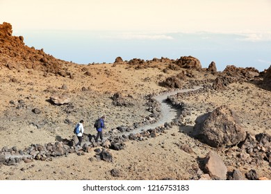 TENERIFE, SPAIN - OCTOBER 29, 2012: Tourists visit volcanic landscape of Teide National Park in Tenerife. The 18,990 hectare national park is listed as a UNESCO World Heritage Site.