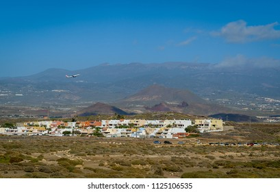 Tenerife Sur airport view with a airplane taking off and Teide mountain at the background. Canary island, Spain.