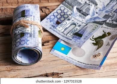 Tenge. Kazakhstan paper money on a wooden background.