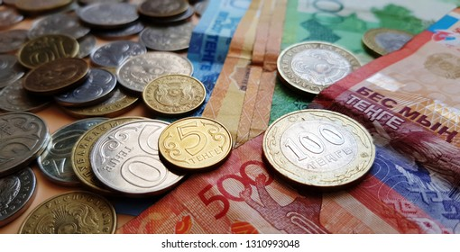 Tenge. Money. Kazakh coins and bills are on the table close-up.