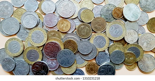 Tenge. Money. Kazakh coins on the beige table top view.