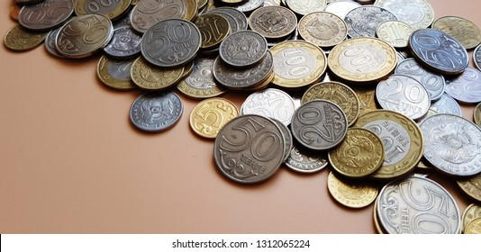 Tenge. Money. Kazakh coins on the beige table close-up.